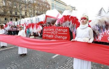 """O que queremos dizer com """"mudar o sistema, não o clima""""?"""